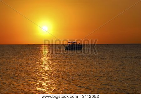 Tropical Sunset And Boat