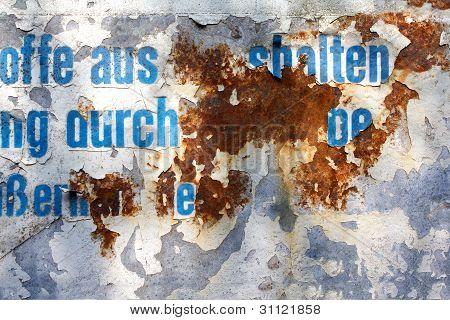 From the rust eaten away inscription