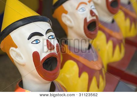 Brightly colored sideshow clowns at a circus