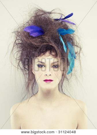 Beautiful young woman with an unusual hairstyle