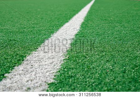 White Stripe Line At The Corner On Artificial Green Soccer Field