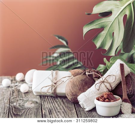 Spa And Wellness Setting With Flowers And Towels. Bright Composition On Brown Background With Tropic