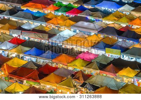 Bangkok, Thailand - March 1, 2019: Aerial view of Talad Rod Fai night market in Bangkok, Thailand