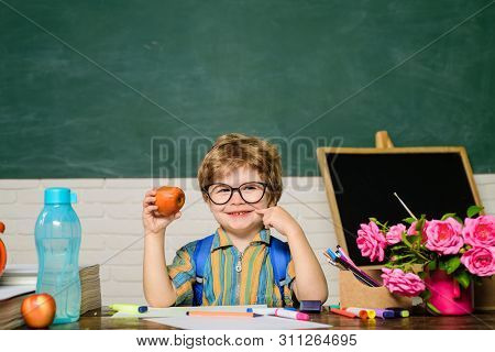 Schoolboy Have Lunch During Break Time. Cute Kid Eating In School. Pupil Enjoy Healthy Lunch. Boy At