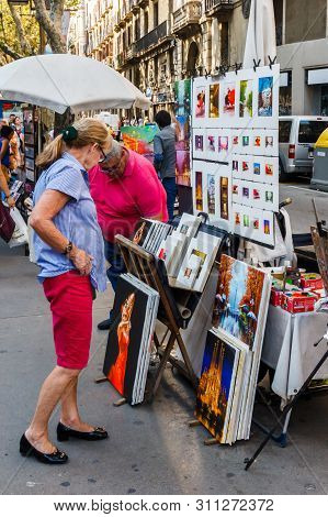 Barcelona, Spain-september 5th 2015: Senior Woman Looking At Paintings For Sale On One Of The Rambla
