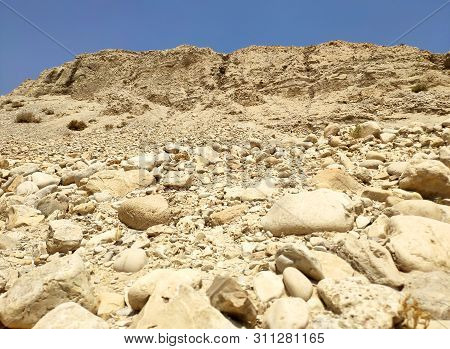 Stones Of The Negev Desert Rocks. Mountains And Hills In The Negev Desert In Israel, Desert Land Bac