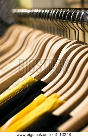 Sale Concept. Clothes Lined Up In Store