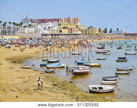 Cadiz, Spain - June 23, 2019. People Enjoying A Sunbathing In La Caleta Beach. View From Duque De Na