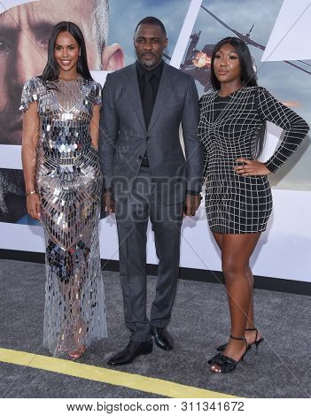 LOS ANGELES - JUL 13:  Sabrina Dhowre, Idris Elba and Isan Elba arrives for the 'Fast & Furious Presents: Hobbs and Shaw' World Premiere on July 13, 2019 in Hollywood, CA