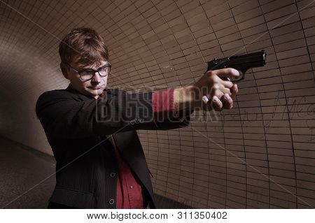 Man In Suit On Alone City Tunnel Place With Handgun