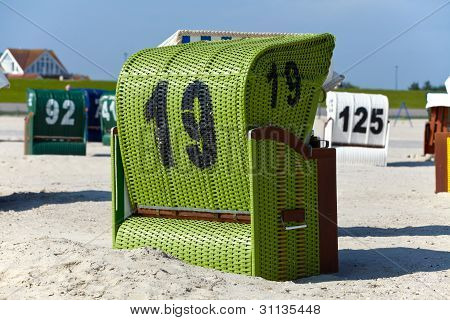 Wicker beach chairs on the beach of the Baltic Sea poster