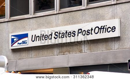 New York, Usa - December 14, 2018: Logo And Signage Of Usps On A Wall. United States Postal Service