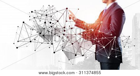 Businessman With Documents Pointing On Abstract Network Structure. Standing Entrepreneur In Business