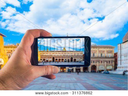 Hand Taking Picture With A Smartphone In Bologna, Piazza Maggiore