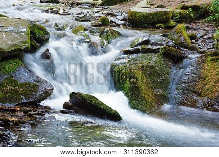 Rapid Forest Steam Among The Mossy Boulders.  Beautiful Nature Scenery In Summer Time