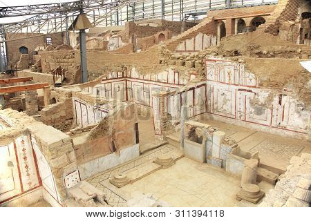 Archaeological Remains With Decorative Tile Floors And Frescoes Paintings In A Hillside House On The