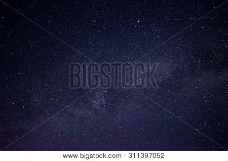 Beautiful Night Sky Full Of Stars. Part Of The Milky Way In The Dark Blue Sky.