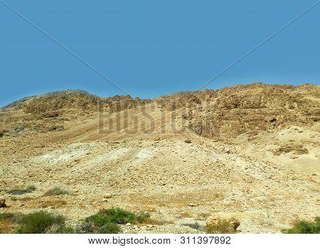 Negev Desert Rocks, Mountains And Hills In Israel, Desert Land Background. Vacation In The Desert