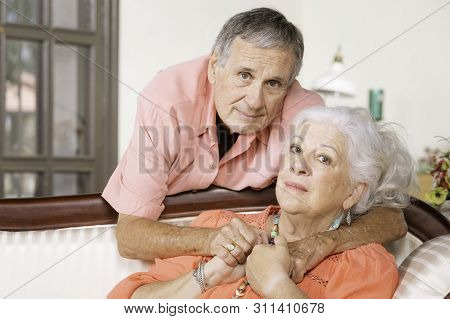 Concerned Or Upset Senior Man And Woman At Home
