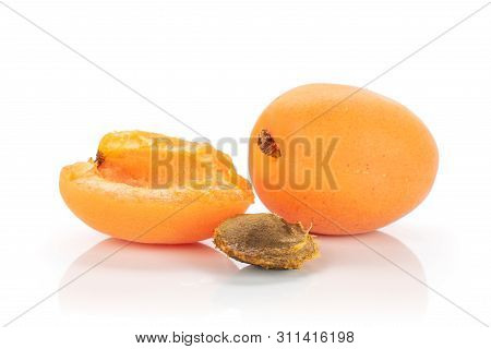 Group Of One Whole One Half Of Meaty Fresh Deep Orange Apricot With A Stone Isolated On White Backgr