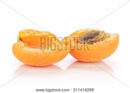 Group Of Two Halves Of Meaty Fresh Deep Orange Apricot With A Stone Isolated On White Background
