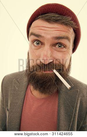 Hipster Brutal Bearded Tobacco Smoker. Man Brutal Bearded Hipster Dressed As Vagabond Smoking Cigare