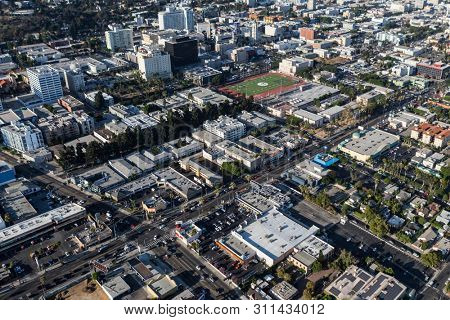 Los Angeles, California, USA - August 6, 2016:  Aerial view of buildings, apartments and streets near Sunset Blvd and La Brea Ave in Hollywood.