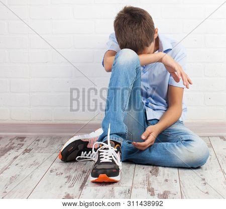 Sad teenager. Problems at school. Grief boy