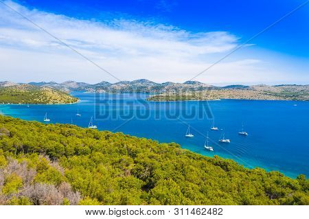 Aerial View Of The Blue Bay And Small Islands In Nature Park Telascica, Croatia, Dugi Otok, Yachts A