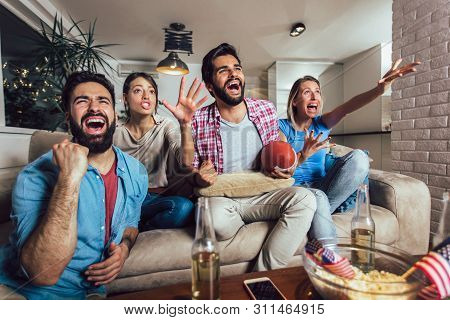 Friends Cheering Sport League Together On Tv And Celebrating Victory At Home.friendship, Sports And