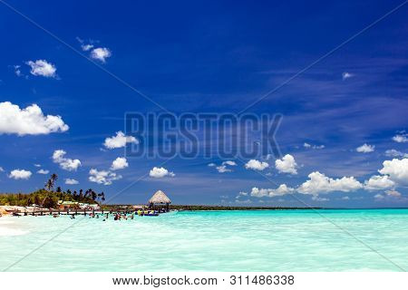 Summer Beach Background. Amazing Tropical Beach With White Sand, Clean Sea And Blue Sky With Clouds.
