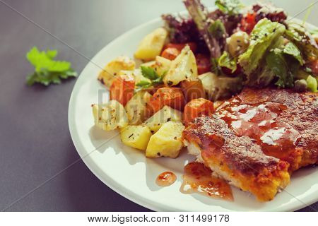Fish Fillet Baked With Cheese With Potatoes, Sweet Potatoes, Carrots And Greens And Vegetables Mix.