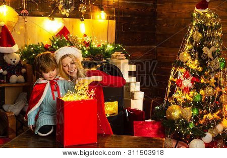 Mom And Kid Play Together Christmas Eve. Happy Family. Mother And Little Child Boy Son Friendly Fami