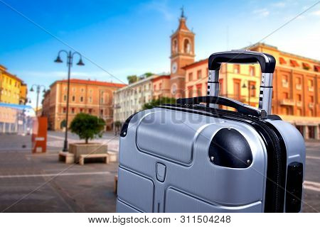Travel Concepts. Luggage Suitcase On European City Background. Voyage With Bag