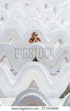 Blonde Caucasian Woman Stands On The Walls Of Myatheindan Pagoda In Mandalay, Myanmar