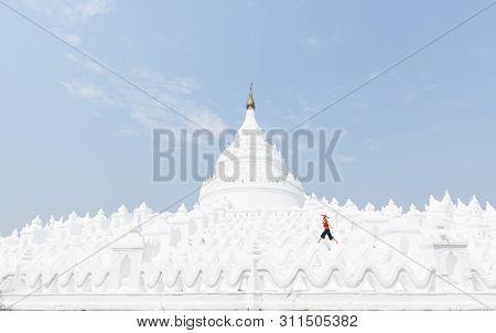 Blonde Caucasian Woman With Red Umbrella Walking On The Walls Of Myatheindan Pagoda In Mandalay, Mya