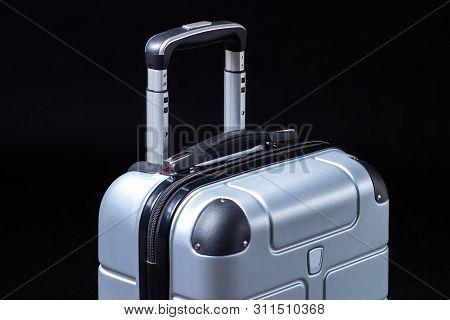 Hand Luggage Suitcase On Black Background. Travel Bag
