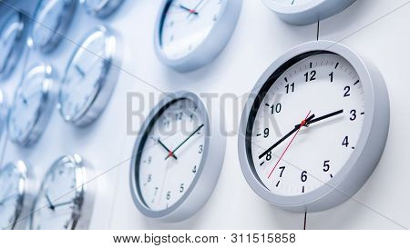 Group Of Simple Round White Wall Clocks Displayed On The Wall In Furniture Store. Home Decoration Co