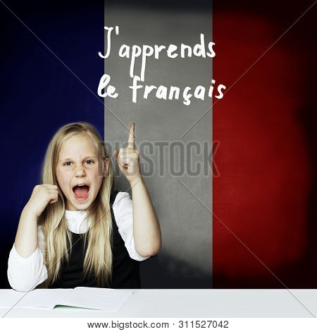 Learn French Language Concept. Happy Child Girl Student Pointing Up On The Tittle