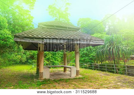 Wooden Gazebo Near The Chong Fah Waterfall, Khao Lak, Thailand. Green Forest Background
