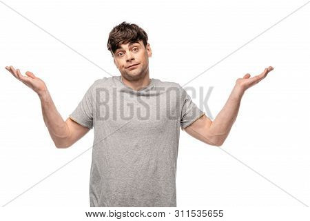 Discouraged Young Man Showing Shrug Gesture While Looking At Camera Isolated On White