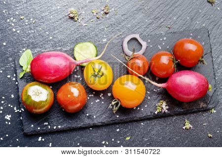 Top View At Fresh Organic Vegetables On Slate Stone Tray With Spices Aside Closeup Dark Concept Phot