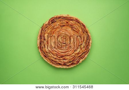 American Traditional Thanksgiving Pie With Apple Filling, In Shape Of A Rose Flower, On Green Backgr