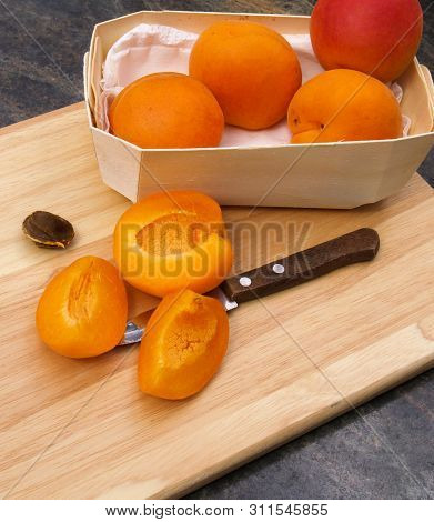 Fresh Apricots Being Prepared On Wooden Chopping Board Fresh Whole Apricots In Wooden Bowl, Halved A