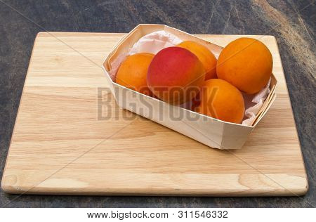 Fresh Apricots Being Prepared On Wooden Chopping Board Fresh Whole Apricots In Wooden Bowl, Being Pr