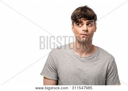 Discouraged Young Man In Grey T-shirt Looking Away Isolated On White