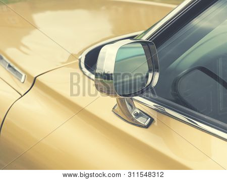 Sideview Mirror Of An Old Vintage Car, Conceptual Vintage Background With Space For Text