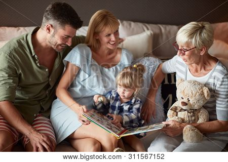 Happy family with little child having fun with grandma