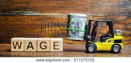 Wooden Blocks With The Word Wage, Dollars And A Forklift. Financial Compensation. Salary Payment To