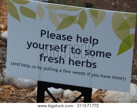 A Sign Placed In A Community Garden At The Entry Of A Herb Garden Offers Advise And Opens The Door O